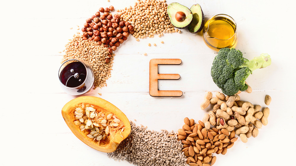 different foods containing vitamin e on a table