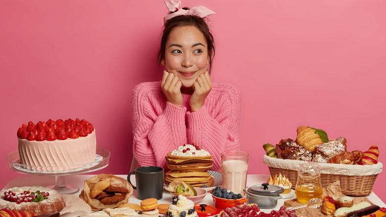 woman surrounded by desserts