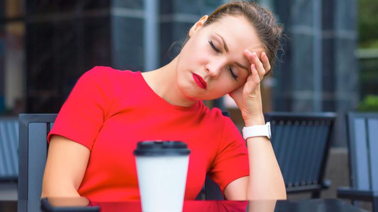 Woman sleeping at table
