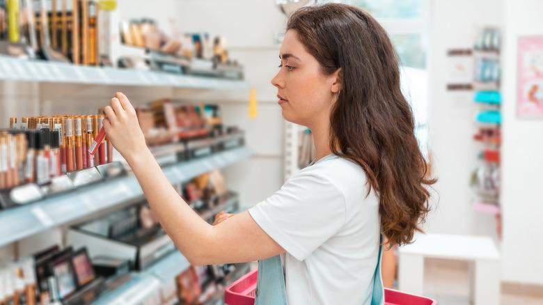 Woman choosing makeup at store
