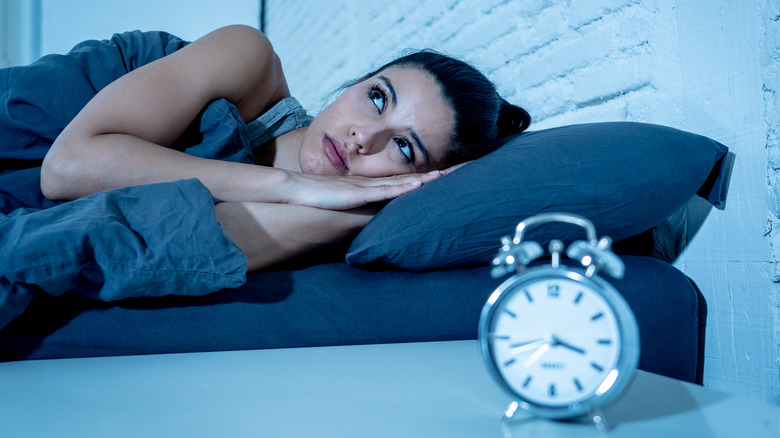 woman with insomnia awake in bed