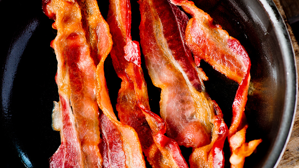 cooked crispy bacon in a cast iron skillet