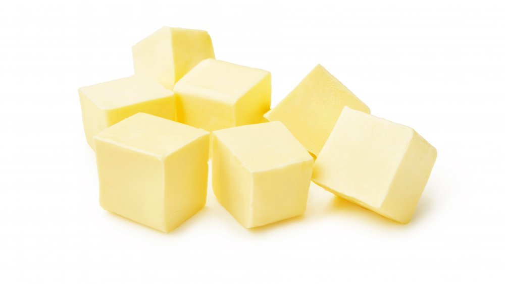 Cubes of butter on a white background