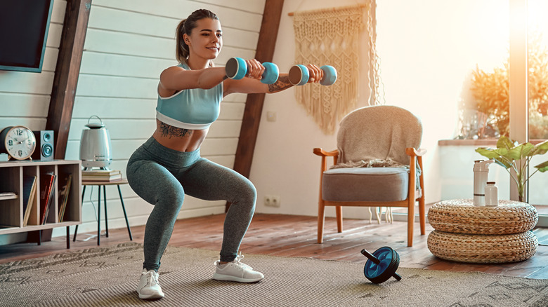 Fit woman working out at home