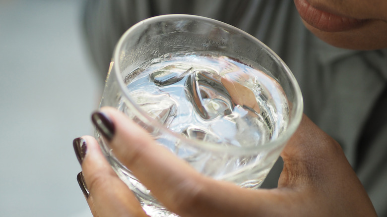woman holding ice water