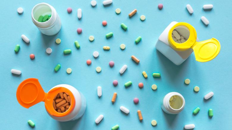 assortment of pills and pill bottles