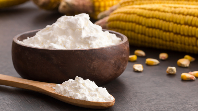 cornstarch in a bowl with corn in the background