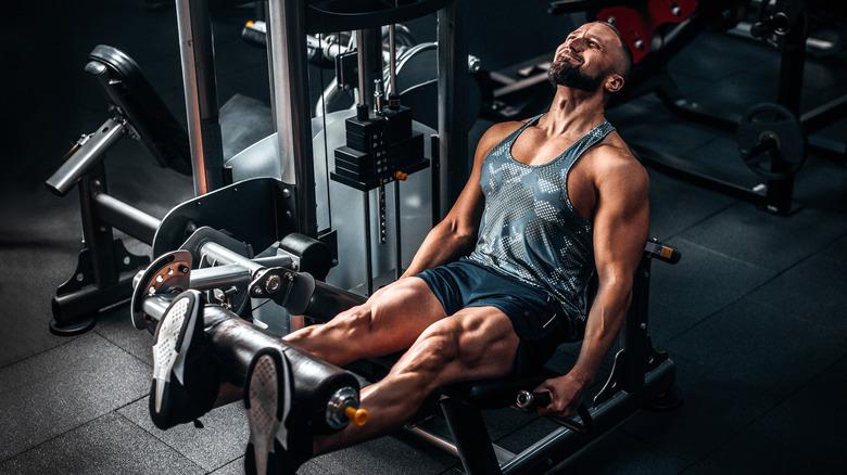 Man on leg machine at the gym