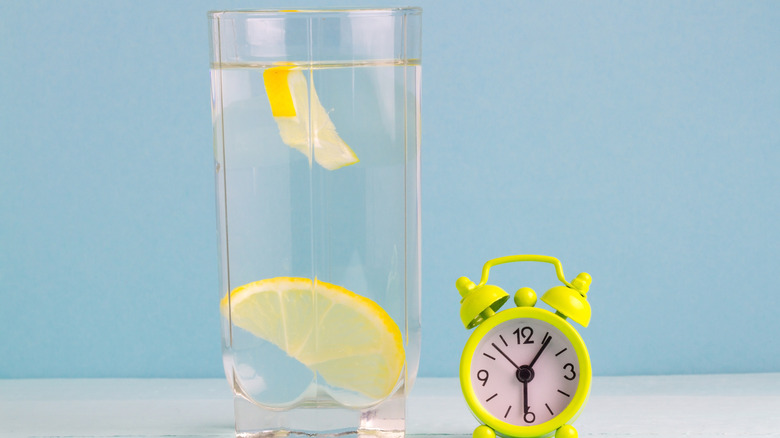 glass cup of water with lemon slice