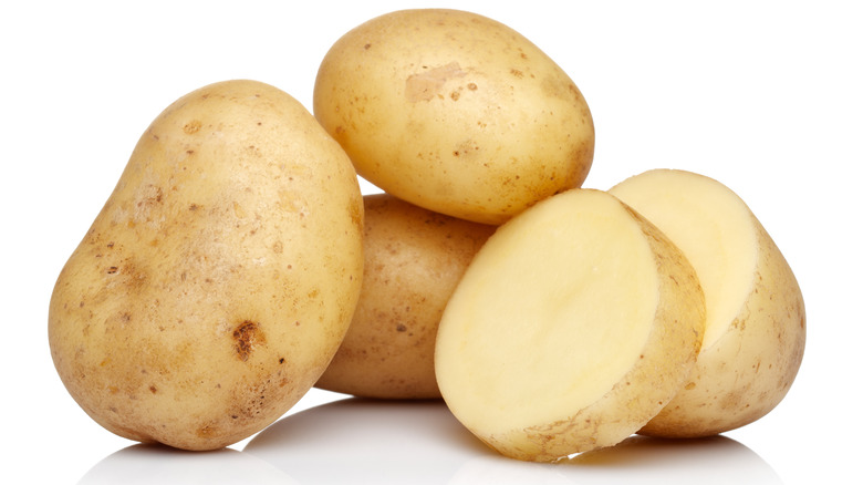 raw potatoes in an isolated white background