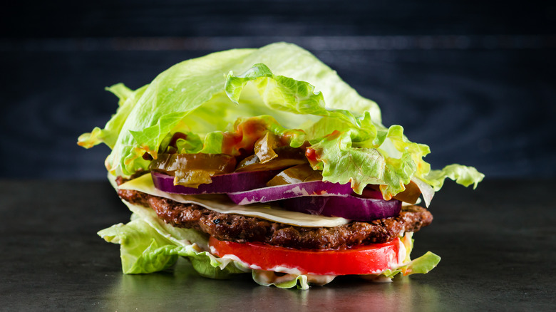 A burger wrapped in lettuce