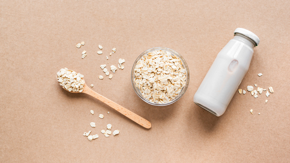 Oats and milk bottle on table