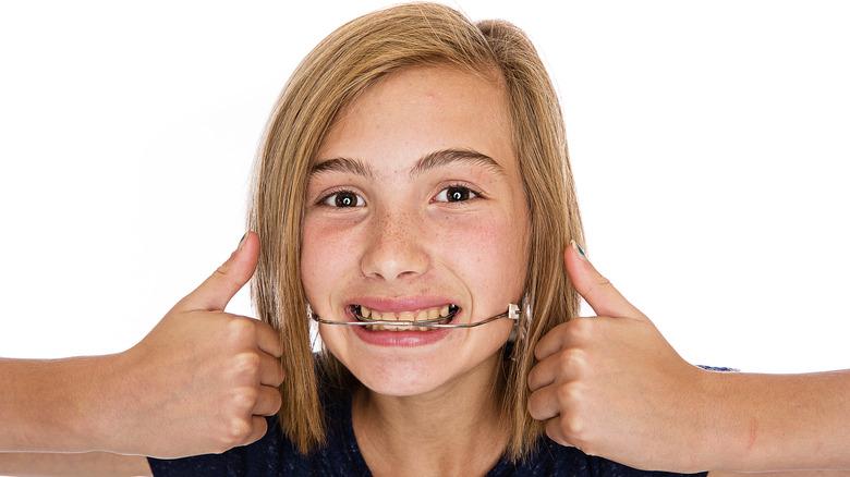 Girl wearing headgear