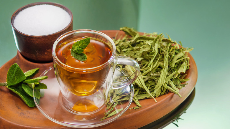 Dry leaves and liquid and granulated Stevia