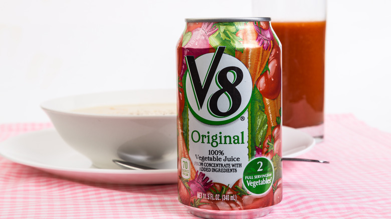 A can of V8 juice sits on a dinner table