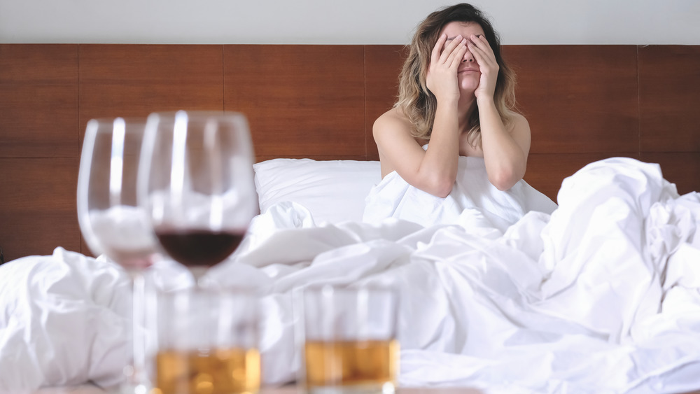 Woman waking up hungover