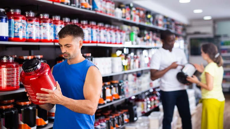 woman drinking supplement before workout