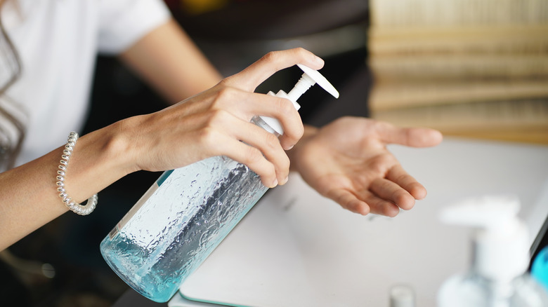 woman pumping hand sanitizer