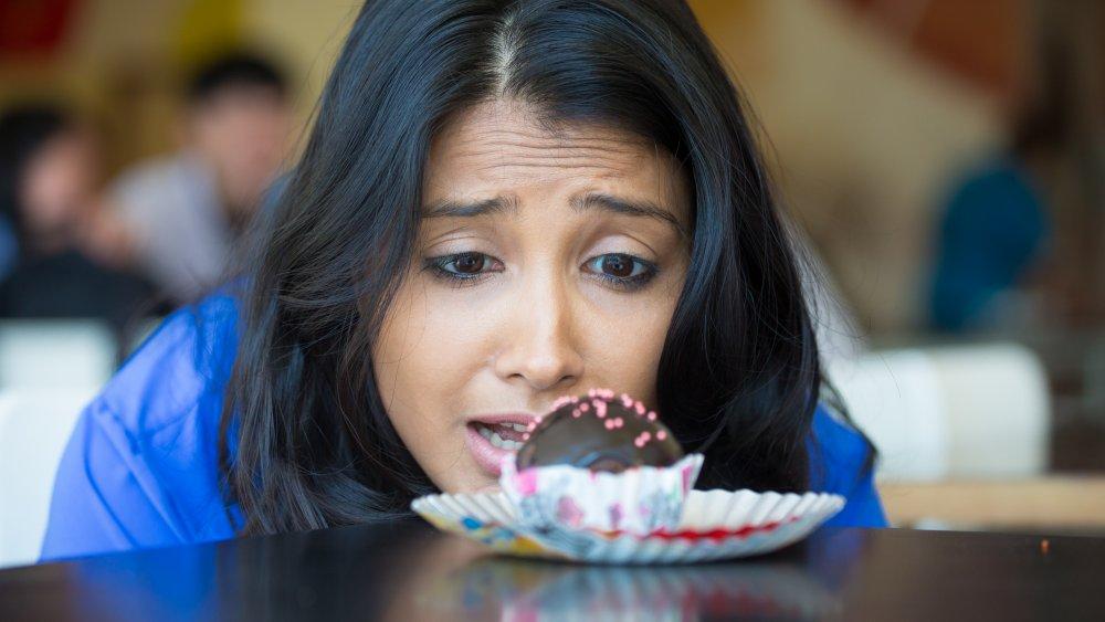 woman looking at a sweet treat
