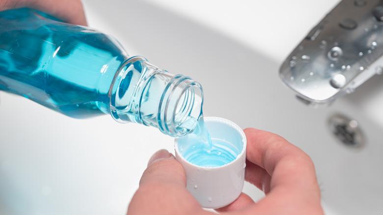 Pouring mouthwash