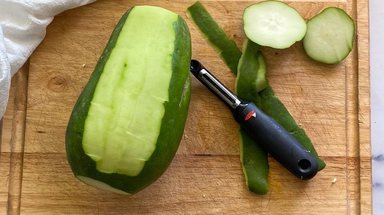 green papaya, partially peeled
