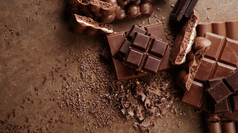 Several types of chocolate sits on a brown table