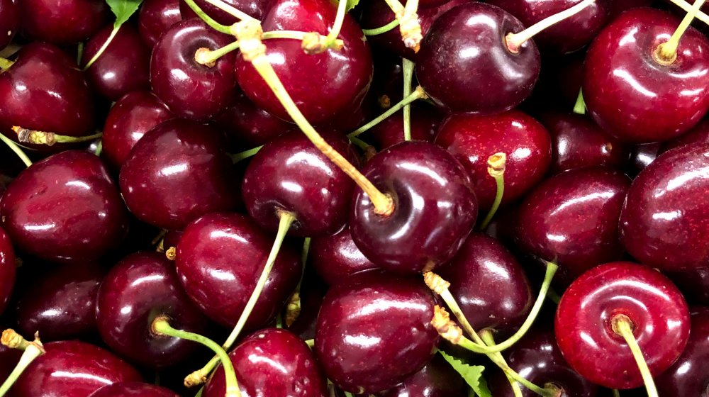 A pile of cherries on their stems