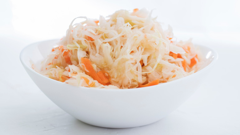 Cabbage and carrot sauerkraut on a white plate