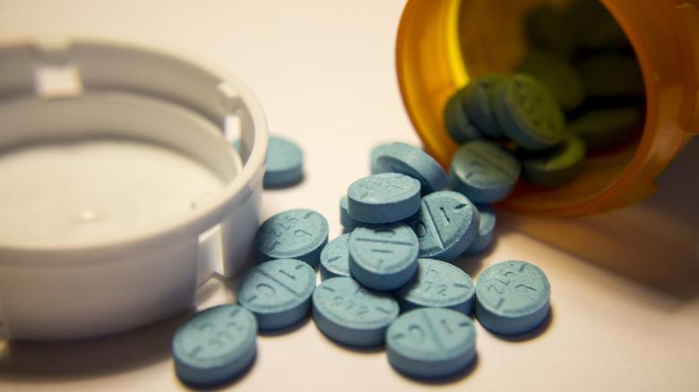 Adderall pills spilling from a prescription bottle
