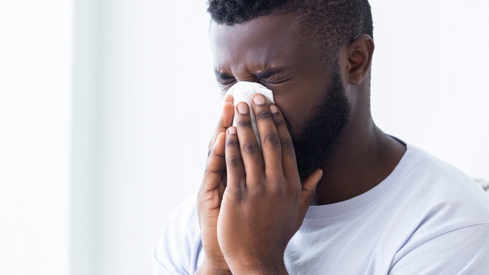Man blowing nose