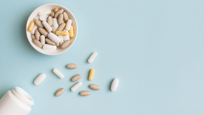 Assorted pills in a white bowl