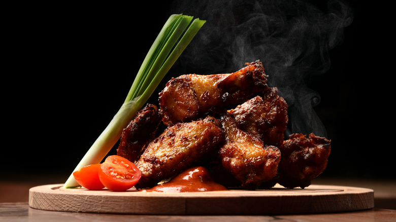 Spicy chicken wings on a plate with celery