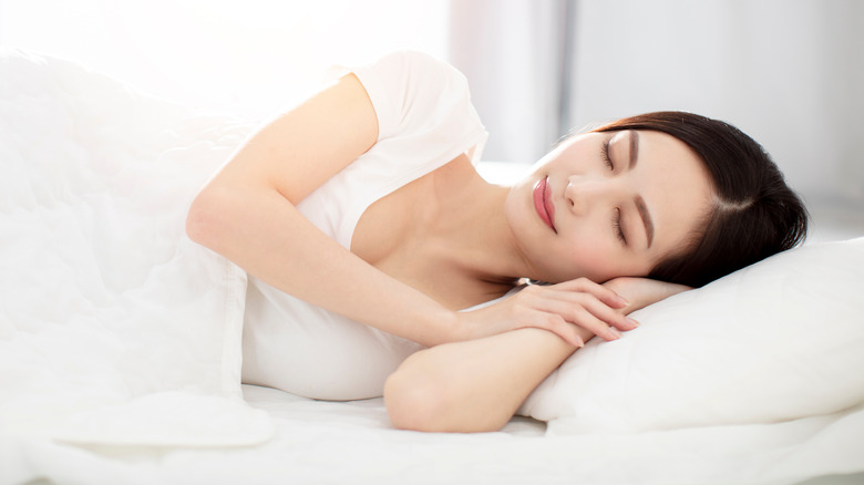 woman lying happily in bed