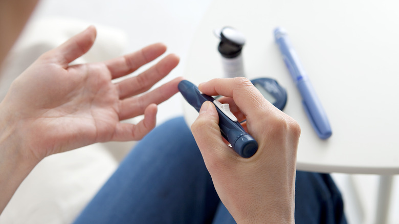 Woman using glucometer