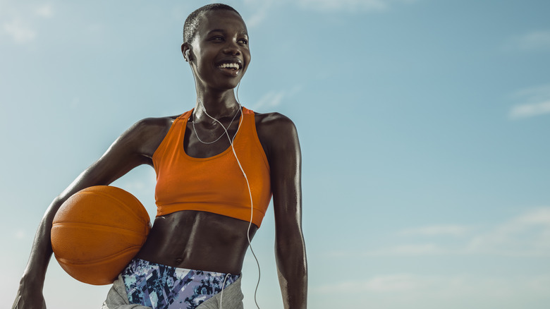 woman holding a basketball
