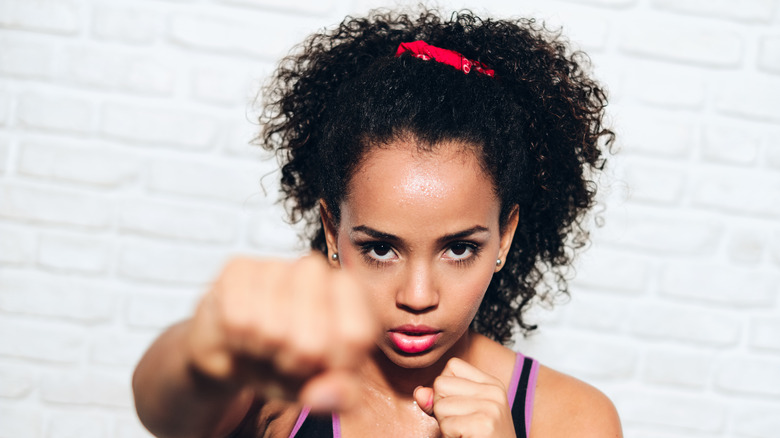 Woman working out and punching