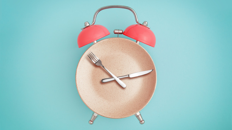 Alarm clock and plate with utensils