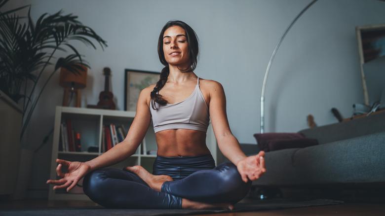 Woman seated in yoga pose meditating