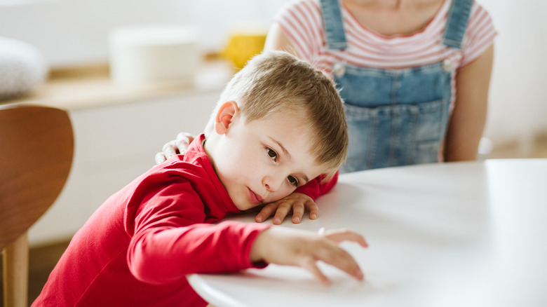 Kid with ADHD sitting at table