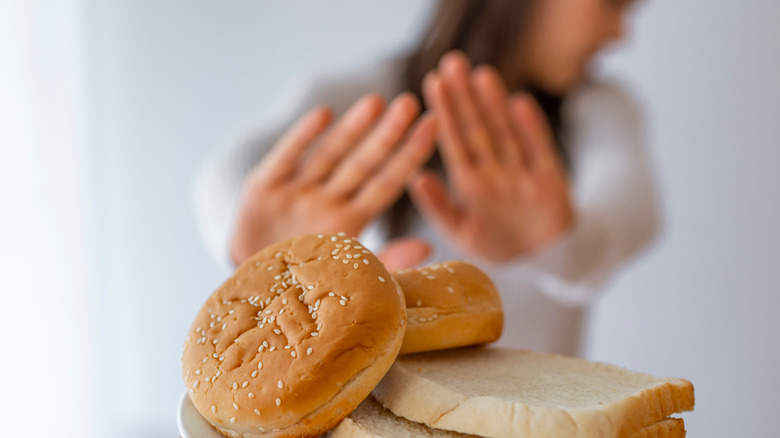 Woman rejecting bread