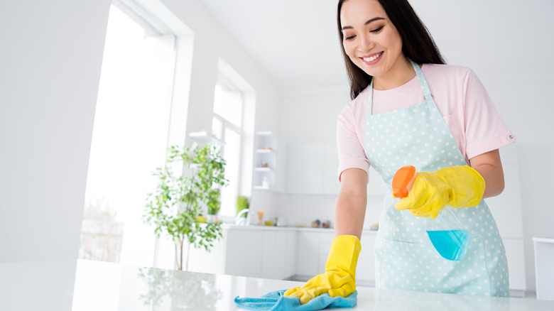 woman disinfecting counter