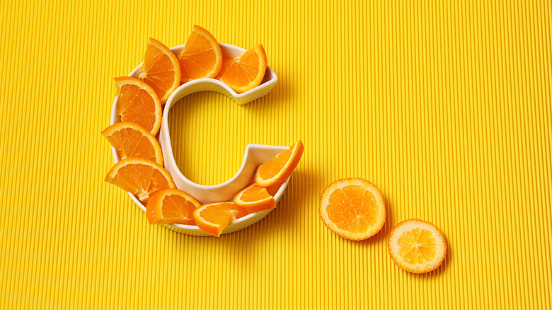 Orange slices in a C formation yellow background