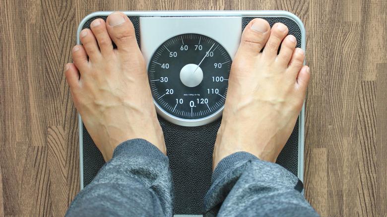man's feet on scale