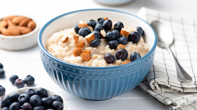 Bowl of oatmeal with almonds and blueberries