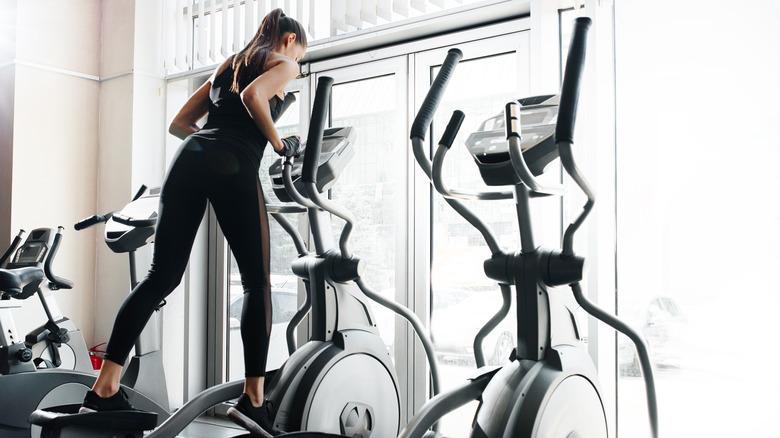 A woman on an elliptical machine