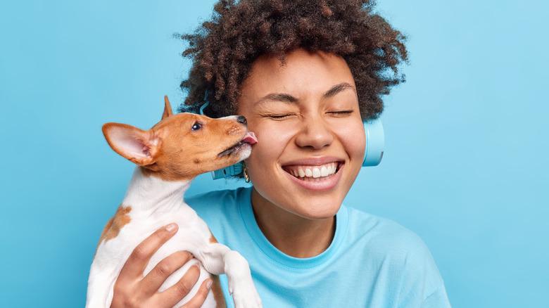 dog kisses woman