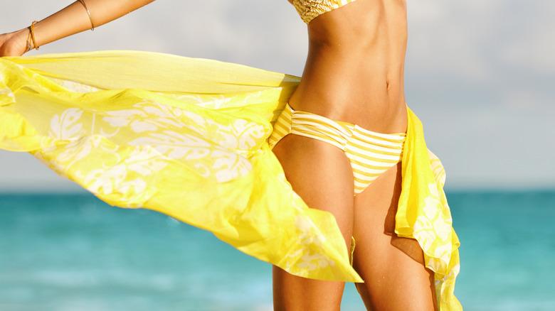 Woman in bikini and scarf
