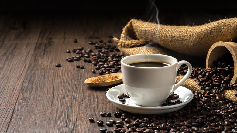 coffee with coffee beans on wooden plank
