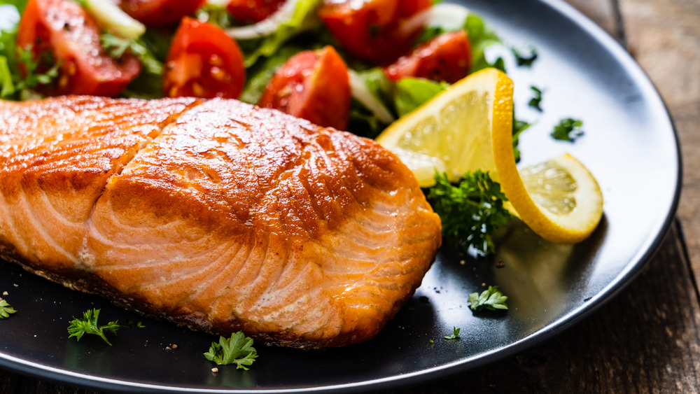 Close up of salmon with vegetables