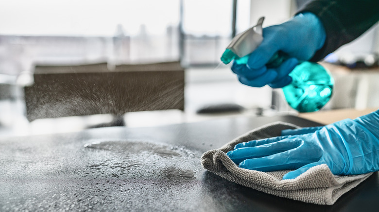 Person disinfecting a counter
